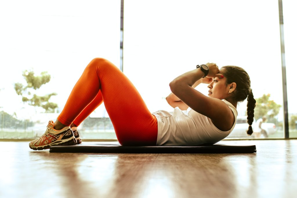 woman exercising to manifest dream body