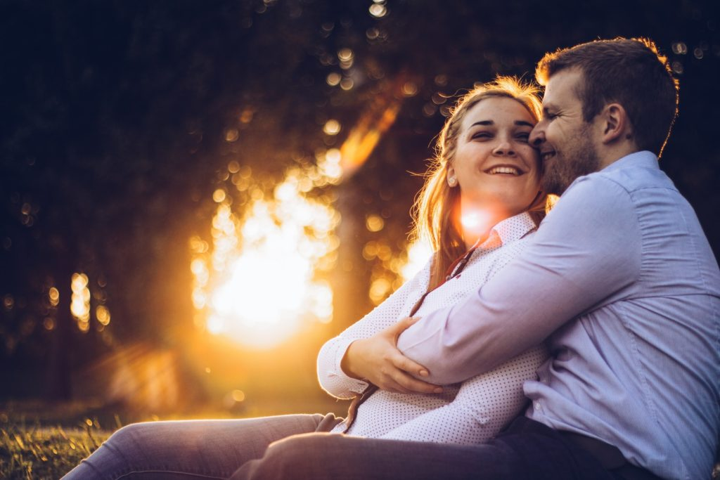 Man initiating physical affection to fix troubled relationship